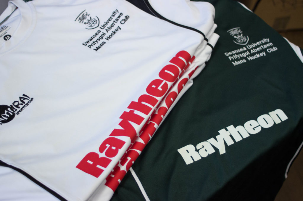 swansea university mens hockey club, raytheon, swansea, back flood press, screen printing, t shirt printing, silk screen, south wales, merch printing, streetwear printing, clothing, clothing brands